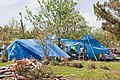 Residents use blue tarps for shelter in Texas.jpg