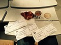 Reviewing our train tickets while having something to eat in the train (32107017153).jpg