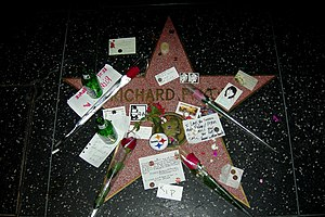 Richard Pryor - Richard Pryor's star at the Hollywood Walk of Fame covered with flowers, beer bottles, fan letters, etc.