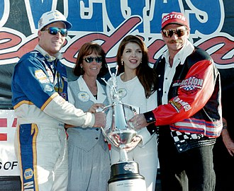 1996 NASCAR Craftsman Truck Series - Ron Hornaday, Jr., wife Lindy Hornaday, and team owners Teresa and Dale Earnhardt celebrate Hornaday's 1996 Truck Series championship