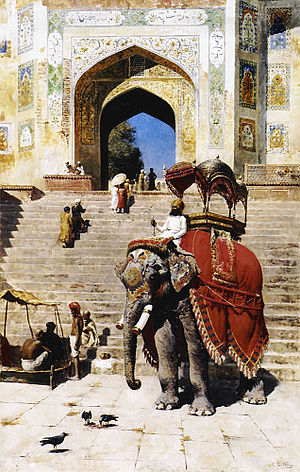 Captive elephants - An elephant wearing a caparison (decorative covering).