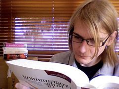 Photo of me reading programming books!