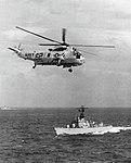 SH-3A Sea King of HS-2 flies over USS Davidson (DE-1045), circa in 1968.jpg