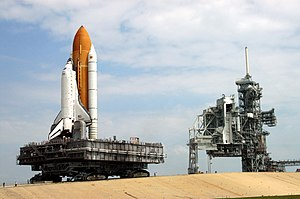 Service structure - Space Shuttle Discovery is carrying by Crawler-transporter, a launch tower is visible in right