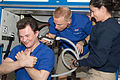 STS-128 ISS-20 Tim Kopra trims Roman Romanenko's hair in the Destiny lab of the ISS.jpg