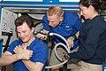 STS-128 ISS-20 Tim Kopra trims Roman Romanenko's hair in the Destiny lab of the ISS.jpg