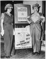 "Safety garb for women workers. The uniform at the left, complete with the plastic ""bra"" on the right, will prevent... - NARA - 522882.tif"