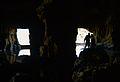 Sala inundada de la cova Tallada i dues persones.JPG