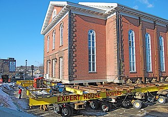 Structure relocation - Hydraulically powered dollies move a historic 19th-century brick church in Salem, Massachusetts.