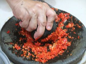 Sambal - A traditional manner of making sambal using an ulekan, a stone mortar