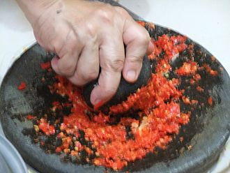 Sambal - A traditional manner of making sambal using a cobek, a stone mortar and an ulekan, a pestle.