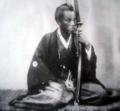 Samurai leaning on his sword.webp