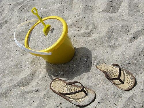 Sand bucket and flip flops