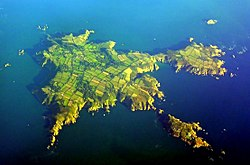 Aerial view of Sark.North is to the lower left, Little Sark toward the upper right and Brecqhou at bottom right.