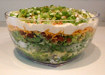 Seven-layer salad is an American dish that inc...