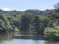 Shuri Castle charred roof over lake 20191102.png