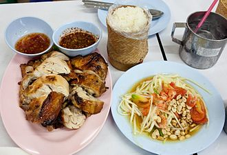 Lao people - A dish of Tam mak hoong, ping gai, and khao nio, a very common Lao meal.