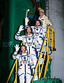 Soyuz TMA-09M crew members wave farewell.jpg