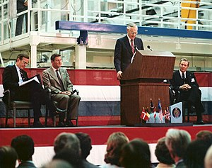 Space Shuttle program - NASA Administrator address the crowd at the Spacelab arrival ceremony in February 1982. On the podium with him is then-Vice President George Bush, the director general of European Space Agency (ESA), Eric Quistgaard, and director of Kennedy Space Center Richard G. Smith