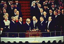 On the Inauguration podium, Agnew is sworn in as Nixon and others look on