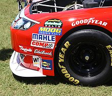 the front of a race car, with the splitter at the bottom