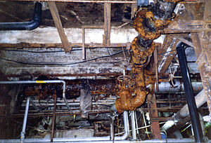 Legal code (municipal) - Building Code Violation: Flammable ABS plastic pipes in a supposedly noncombustible pulp and paper mill in Sault Ste. Marie, Ontario.
