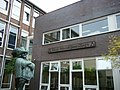 Stanislascollege in Delft, with statue of Cyrano Bergerac.jpg