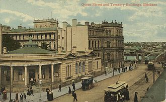 Treasury Building, Brisbane - Treasury Building after Stage 2 with the Registrar-General's building still on the corner of Queen and George Streets, circa 1907. The internal walls facing the internal courtyard can be seen.