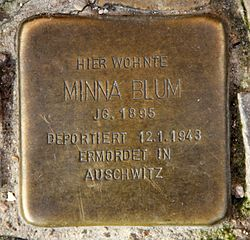 Photo of Minna Blum brass plaque