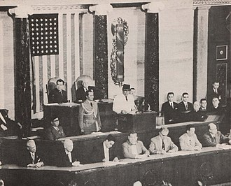 Joint session of the United States Congress - Indonesian President Sukarno addresses Congress in 1956. Sitting behind him Vice President Nixon and Speaker Rayburn.
