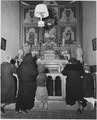 Taos County, New Mexico. Prayer before altar of church at Arroyo Seco. - NARA - 521929.tif