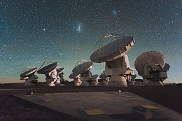 The Atacama Large Millimeter Array (ALMA) by night, under the Magellanic Clouds.jpg