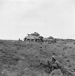 139th (Sherwood Foresters) Brigade - Sherman tanks supporting infantrymen of the 2/5th Battalion, Leicestershire Regiment, 46th Division, near Coldazzo on the Gothic Line, 30 August 1944.