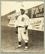 Stengel stands in the outfield, playing his position and wearing sunglasses