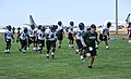 The University of Hawaii football team members, the Warriors, practice at Joint Base Pearl Harbor-Hickam Aug. 15, 2013, in Hawaii 130815-N-IU636-208.jpg