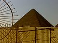 The iron fence looks like the sun disc with its rays over the pyramid.jpg
