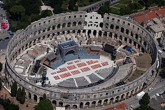 Pula Arena, the only remaining Roman amphitheatre to have four side towers and with all three Roman architectural orders entirely preserved. The new old amphitheater in Pula Istria (19629095974).jpg