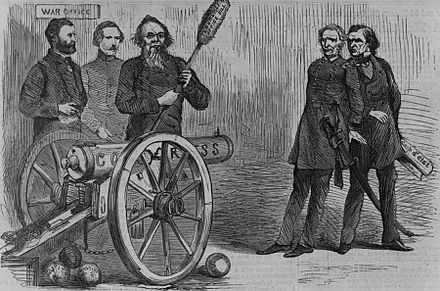 """The Situation"", a Harper's Weekly cartoon gives a humorous breakdown of ""the situation"". Stanton aims a cannon labeled ""Congress"" on the side at President Andrew Johnson and Lorenzo Thomas to show how he was using Congress to defeat the president and his unsuccessful replacement. He also holds a ramrod marked ""Tenure of Office Bill"" and cannonballs on the floor are marked ""Justice"". Ulysses S. Grant and an unidentified man stand to Stanton's left. The situation.jpg"