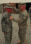 Thomas promoted to staff sergeant at Kandahar Airfield Humanitarian Assistance Yard DVIDS413956.jpg