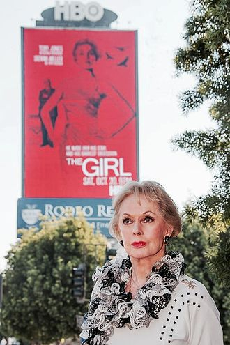 Tippi Hedren - Hedren in front of The Girls poster in 2012
