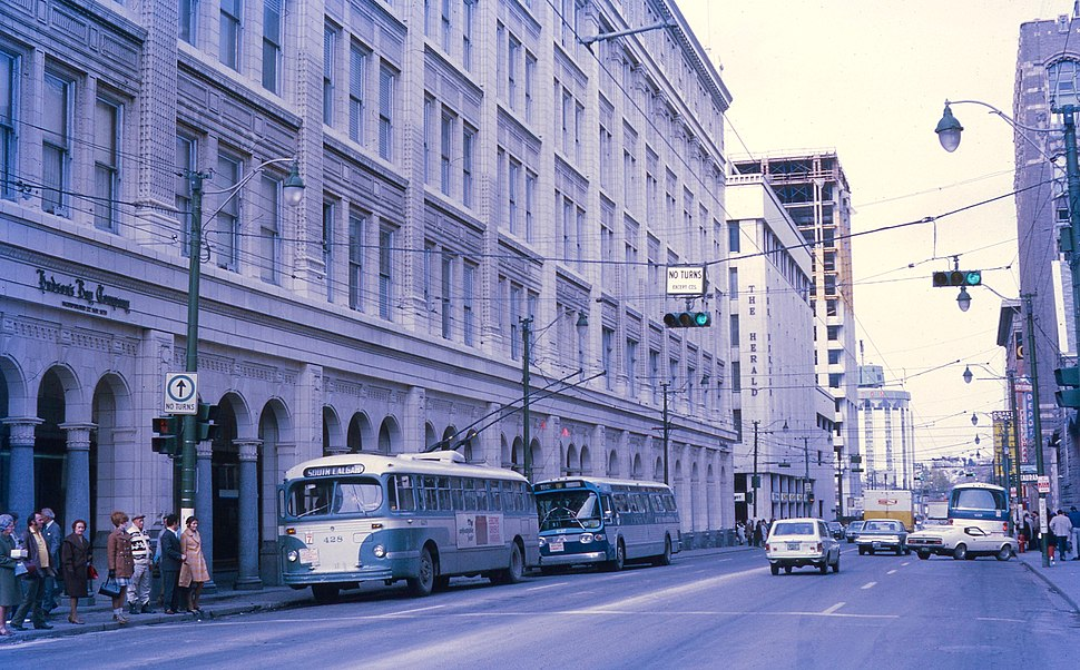 Trolleybus next to Hudson%27s Bay Company store in Calgary in 1971