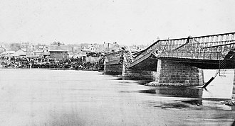 Dixon Bridge Disaster - The Dixon (Ill.) Truesdell Bridge Collapse, May 1873. View: looking north.