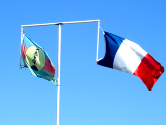 Flag of New Caledonia - Official flags side by side on the same flagpole, Nouméa, March 2011.