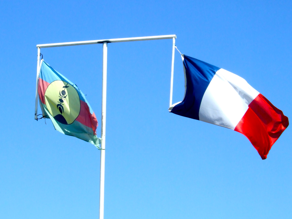 Two official flags of New Caledonia on same flagpole