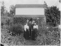 Two unidentified white couples with Chinese man in front of a house. - NARA - 297704.tif