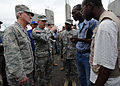 U.S. Air Force Gen. Douglas Fraser, commander of U.S. Southern Command, listens as Army Lt. Gen. Ken Keene, Joint Task Force-Haiti, asks a camp leader how the conditions are in the camp at Ancien Aeroport 100306-N-HX866-015.jpg