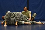 U.S. Army Spc. Charles Welling, right, assigned to the 1st Battlefield Coordination Detachment, monitors two Airmen practicing ground grappling side control during the Modern Army Combatives Program's Basic 140113-F-ZT243-090.jpg