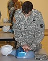 U.S. Army Spc. Hayden Moyer-Cadorette does chest compressions on a mannequin at the Camp Sherman Readiness Center in Chillicothe, Ohio, June 4, 2013 130608-A-EU423-701.jpg