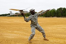U.S. Army Staff Sgt. Edwin Williams, an instructor with the 218th Leadership Regiment, South Carolina Army National Guard, launches an RQ-11B Raven unmanned aerial system at McCrady Training Center, Eastover 131121-Z-ID851-264.jpg