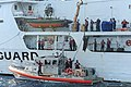 U.S. Coast Guardsmen aboard the high-endurance cutter USCGC Gallatin (WHEC 721) transfer contraband to a Response Boat-Medium, front, during Operation Martillo in Miami June 7, 2013 130607-G-KU792-656.jpg